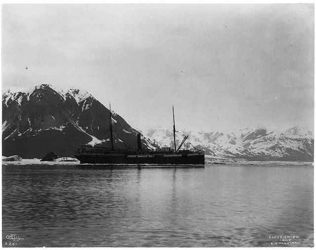 [Ship, GEORGE W. ELDER, in ice on bay with mountains behind, Alaska or the Aleutian Islands]