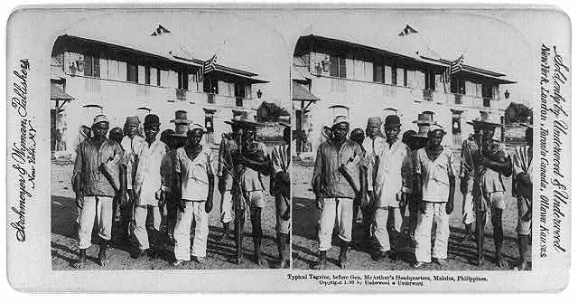 Typical Tagalos, before Gen. McArthur's headquarters, Malolos, Philippines