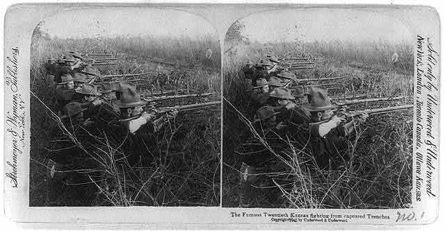 The famous Twentieth Kansas fighting from captured trenches, [Philippine Islands]