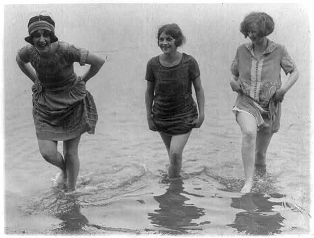 Three models from Washington's spring fashion show [wading] snapped at Arlington Beach