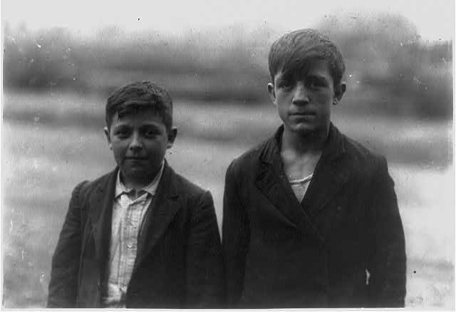 Albert Heon - 14 years old. Frank Migneault - 15 years old. Doffers in Kerr Thread. Companions of 4239 and 4238 groups about the same age - all French but differing in strength.  Location: Fall River, Massachusetts