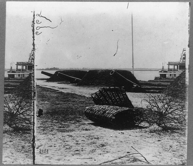 """Three gun battery on """"The Battery,"""" Charleston, S.C.--The gun in distance was taken from the wreck of the U.S. Ironclad Keokuk"""
