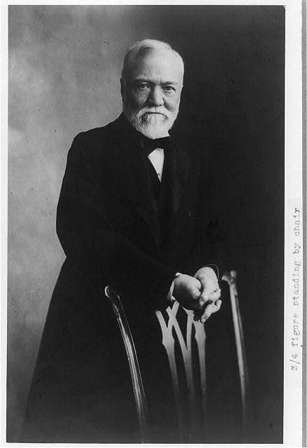 [Andrew Carnegie, three-quarter length portrait, standing behind chair, facing front]