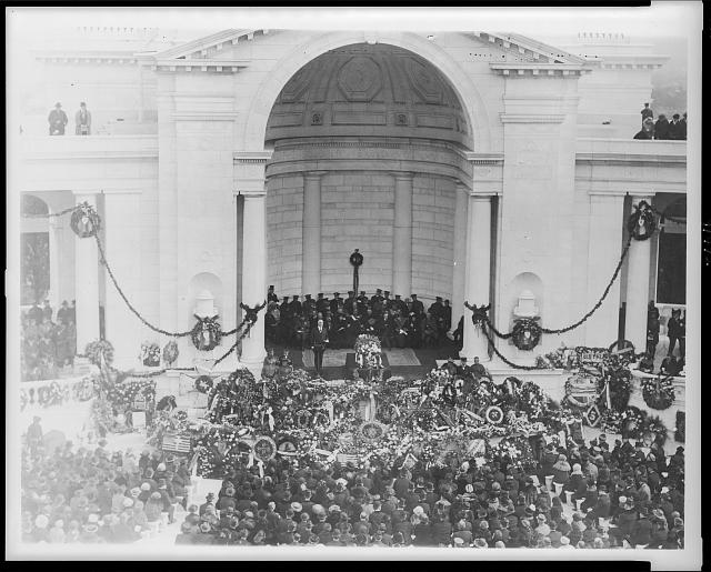 [Burial of Unknown Soldier at Arlington National Cemetery, Va.; President Harding standing beside casket, Nov. 11, 1921]