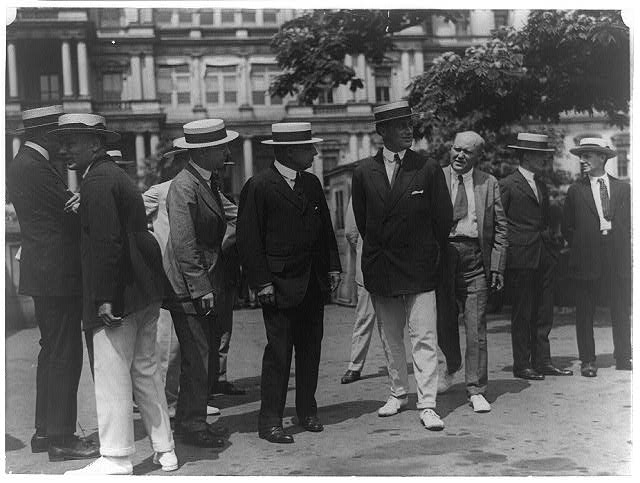 Governor Cox and Franklin D. Roosevelt surrounded by newspapermen as they arrived outside the White House for conference with Pres. Wilson