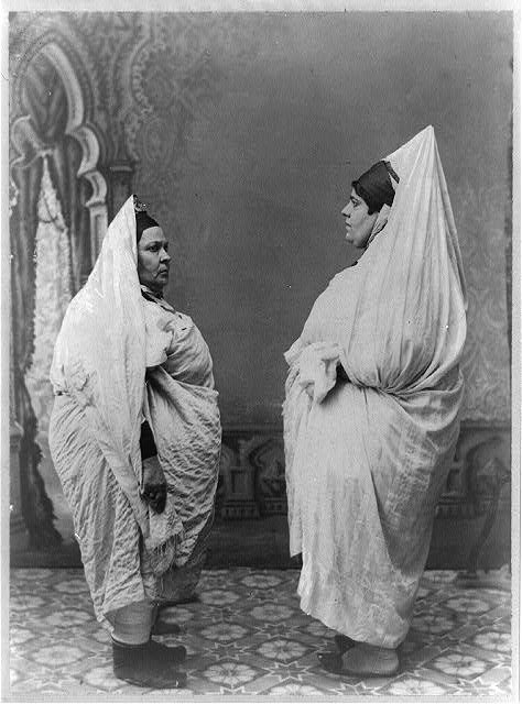 [Two Jewish women standing, facing each other, in Tunisia]