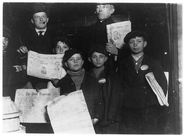 Group of Italian Newsies on South Ave., selling in saloons, and stores. Had just come out of saloon in front of which they are standing. Behind them two typical saloon-patrons who insisted on being in the picture. 10 P.M. Cold. Snowing. Left to right: Joseph Inquagguito, 15 years, 3 Vetter St. Frank Manuel, 10 years old, 21 Fillander St. Tony Nessera, 12 years, 85 Waite St. Tony Compesse, 9 years old, 18 Vetter St. Sam Compesse, 12 years old, 18 Vetter St.  Location: Syracuse, New York (State)