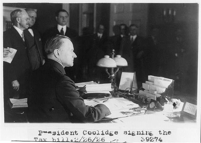 President Coolidge signing the tax bill