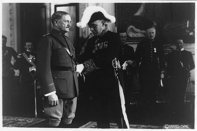 [Sir Aukland Campbell Geddes presenting award to General John Pershing, in front of other men, all in dress uniform]