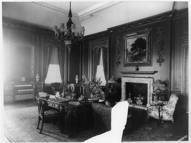 [Interior view of Mrs. Hamilton Rice home in Newport, Rhode Island, with desk and fireplace]