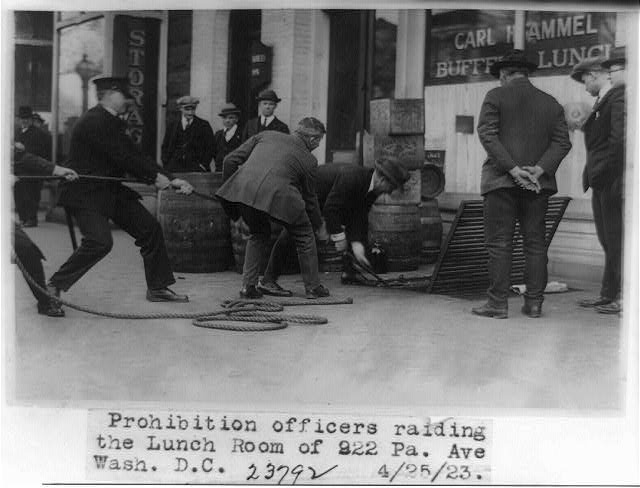 Prohibition officers raiding the lunch room of 922 Pa. Ave., Wash., D.C.