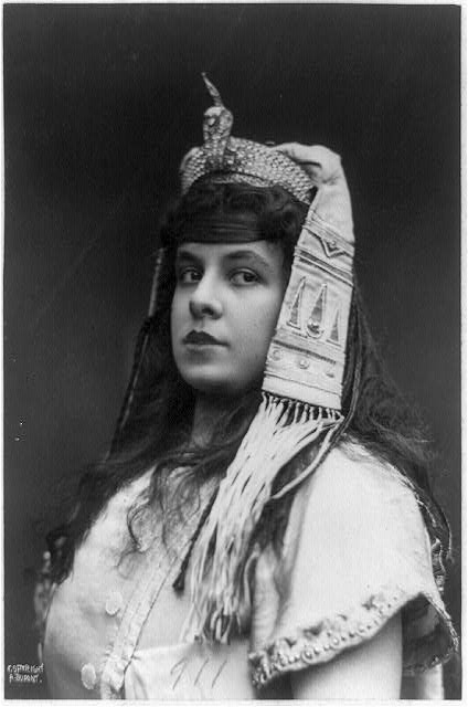 [Maria Gay, head-and-shoulders portrait, facing left, as Aida in costume with exotic headdress and snake ornament]