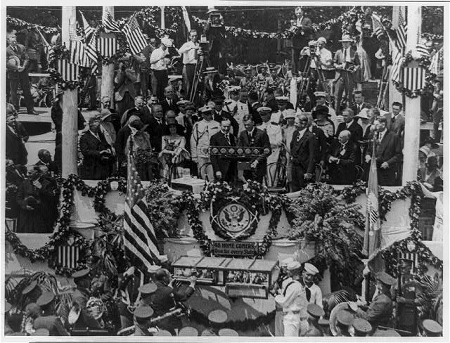 [Charles A. Lindbergh speaking on flag-draped podium, with Calvin Coolidge]