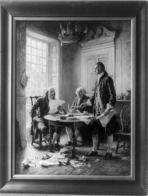 [Benjamin Franklin reading draft of Declaration of Independence, John Adams seated, and Thomas Jefferson standing and holding feather pen and paper, around table]
