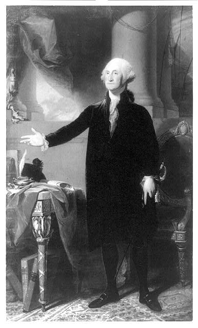 [George Washington, full-length portrait, standing, facing left, right hand raised above table]