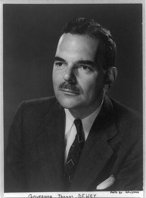 [Thomas Edmund Dewey, head and shoulders portrait, facing left]