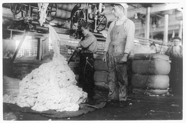 Young boy on warping machine Elk Cotton Mills.  Location: Fayetteville, Tennessee.
