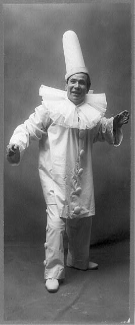 [Amadeo Bassi, full-length portrait, standing, facing right, in clown (Pagliacci?) costume]