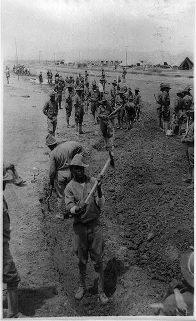 [With the U.S. troops in Mexico--black soldiers digging a ditch for rain water to flow off]