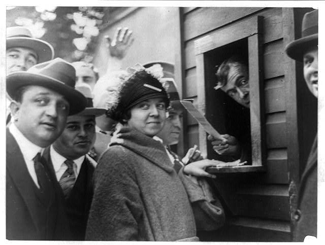 Miss Elsie Tydings, who had the distinction of purchasing the first ticket sold for a World Series in the National Capitol. Miss Tydings was No. 1 in the first line selling tickets this morning