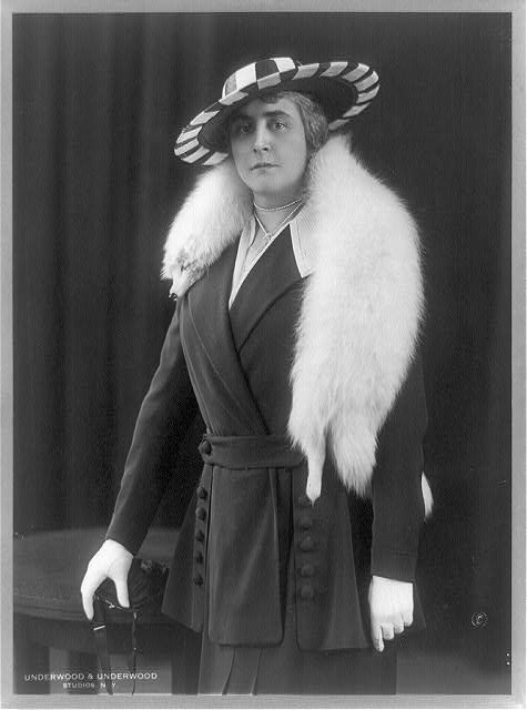 [Anne Morgan, three-quarter length portrait, standing, facing front, wearing fur stole]