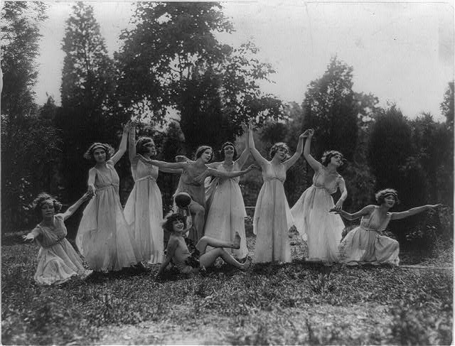 [Eight women and one child(?) performing Greek dance outdoors, Washington, D.C. area]