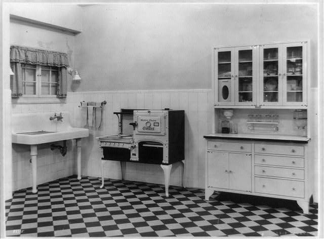 Sink, Western Electric stove, and cabinet in a model kitchen