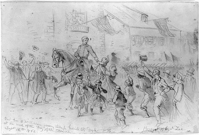 Genl. Geo. B. McClellan passing through Frederick City Myd. at the head of the Army of the Potomac. Pursuit of Genl. Lee