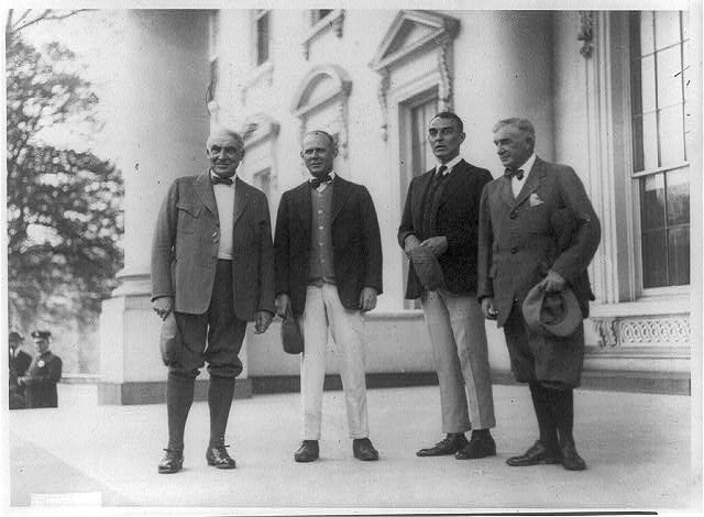 [Pres. Harding, Grantland Rice, Ring Lardner, and Henry P. Fletcher posed, standing, full-length portrait, outside the White House]