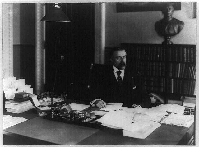 [Herbert L. Satterlee, half-length portrait, seated at desk, facing right]