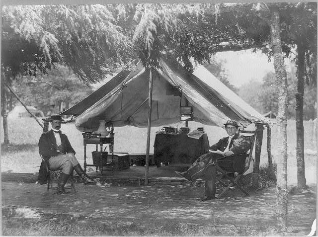 2 officers of the staff of General A.A. Humphrey [seated in front of tent]