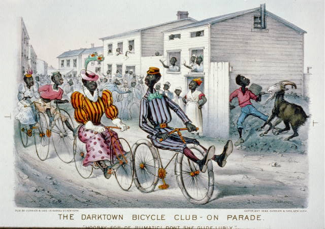 "The darktown bicycle club - on parade: ""Hooray for de rumatic! Dont she glide lubly."""
