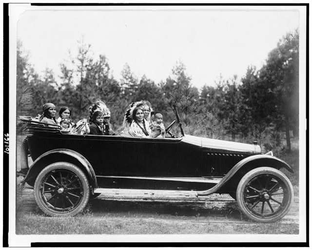[Coeur D'Alene man, Phillip Wildshoe and family, in his Chalmers automobile]