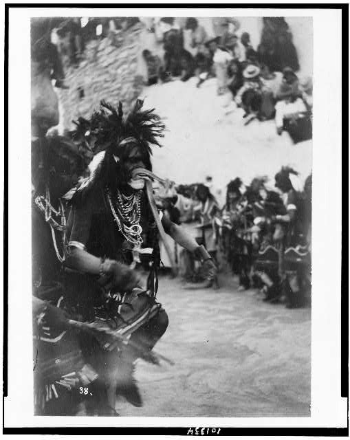 [Hopi snake priest with snake in his mouth in the Hopi Snake dance]