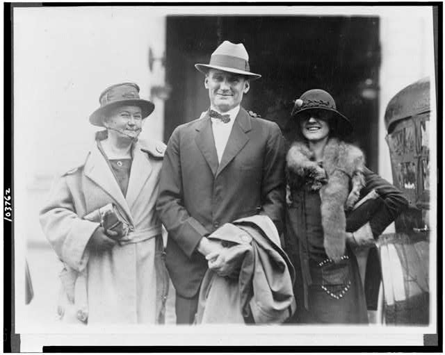 Walter Johnson with his wife and mother returning to the city