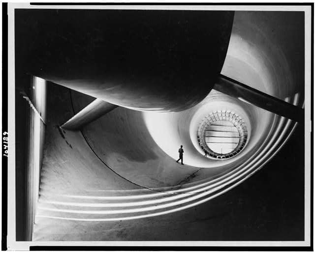 Interior view of the long air return passage in the 16-foot transonic wind tunnel at Langley Aeronautical Laboratory ...