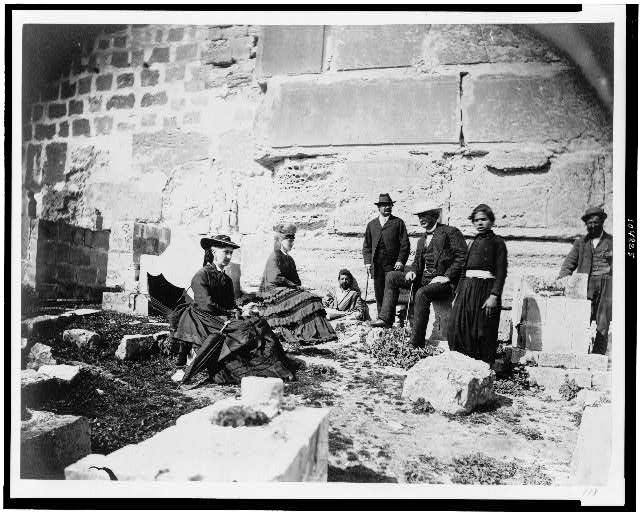 [Group of tourists with indigenous people outside walls of Jerusalem]