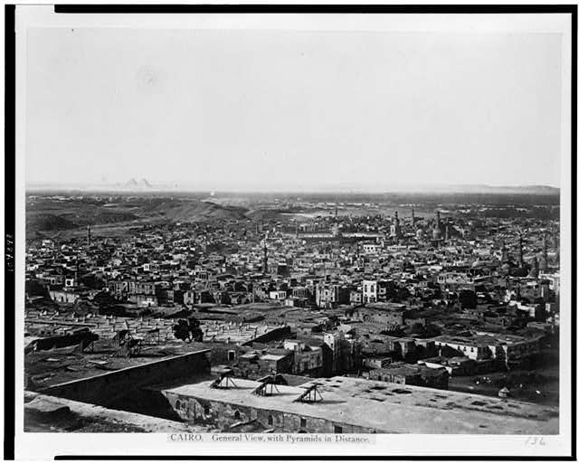 Cairo. General view, with pyramids in distance
