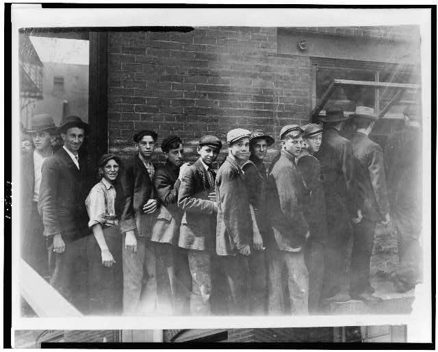 The Line Waiting for Pay in an Indianapolis Meat Packing House. Aug., 1908. Wit., E. N. Clopper.  Location: Indianapolis, Indiana.