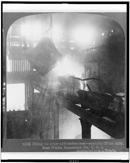 Filling the mixer with molten iron - emptying 20 ton ladle, steel works, Homestead, Pa., U.S.A.