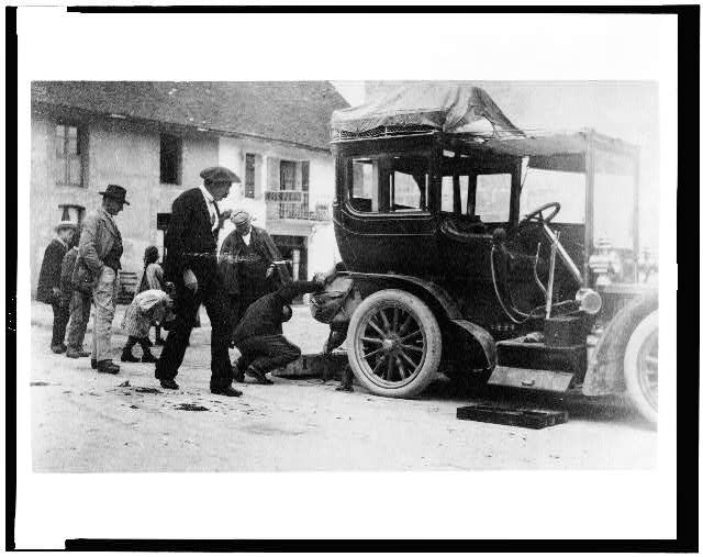 [Examination of luggage on automobile, by Customs(?), France]