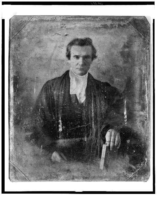 [Rev. Henry Anthon, half-length portrait, facing front, wearing robe, holding book]