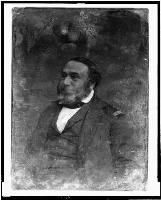 [Unidentified man, about 55 years of age, half-length portrait, three-quarters to the left, with patch on shoulder]