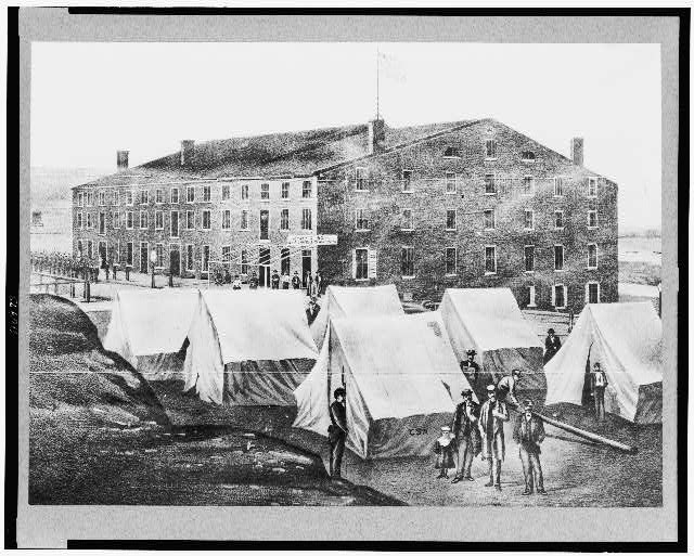 [Soldiers, other people, and tents of Confederates outside of Libby Prison, Richmond, Virginia]