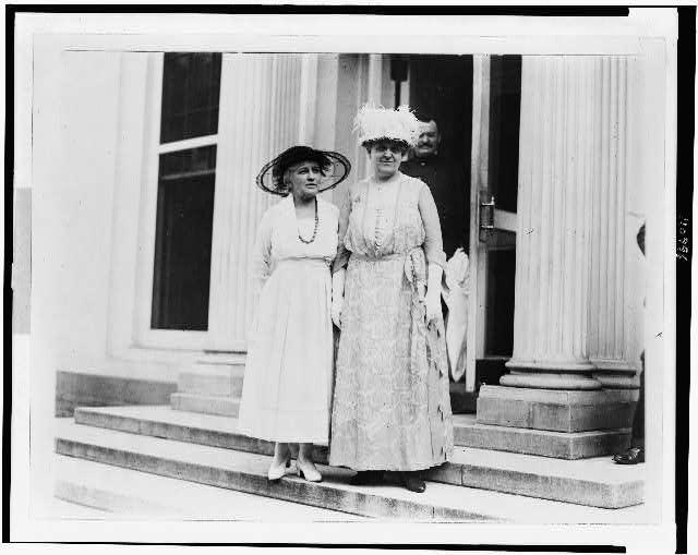 [Mrs. Helen Gardener and Mrs. Carrie Chapman Catt leaving the White House]