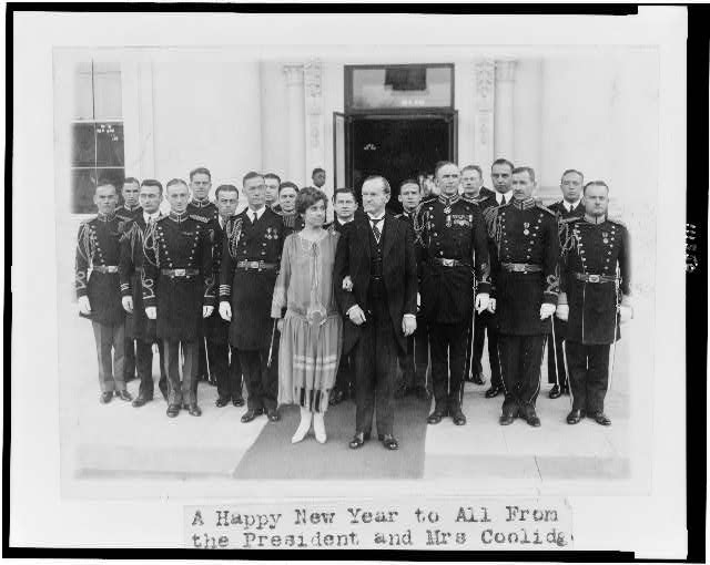 [President and Mrs. Coolidge with military aides, just after they assisted in a New Year reception, posed outside the White House]