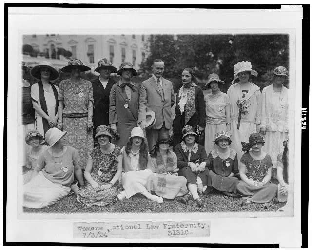 [President Coolidge posed with Women's National Law Fraternity, on lawn]