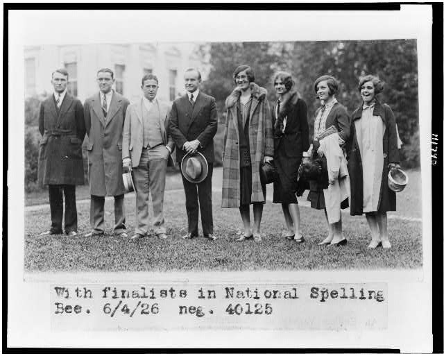 [President Coolidge, standing, full-length, with the seven finalists in the national spelling bee]