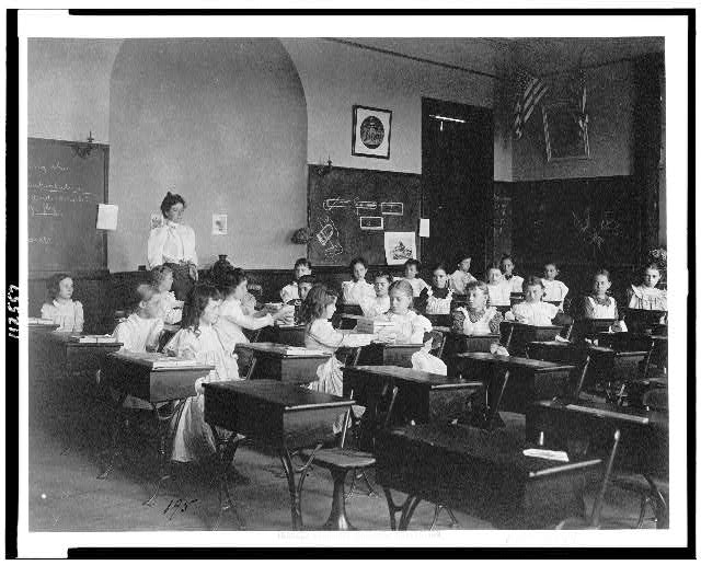[Young girls seated at desks in Washington, D.C. classroom]
