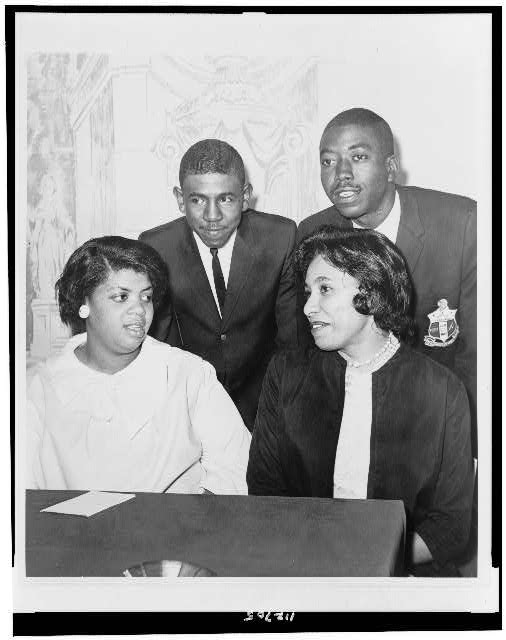 [Linda Brown Smith, Ethel Louise Belton Brown, Harry Briggs, Jr., and Spottswood Bolling, Jr. during press conference at Hotel Americana]